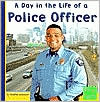 A Day in the Life of a Police Officer (First Facts Community Helpers at Work Series) - Heather Adamson, Jim Foell (Photographer), Designed by Jennifer Schonborn, Jeffrey B. Bumgarner